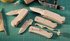 Wooden pocket knife kit to teach children about the mechanics of folding knives.