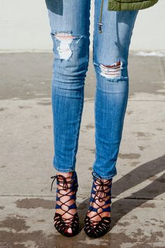 Ripped Jeans + blue & black lace up heels & green jacket.