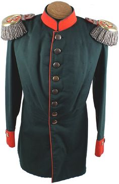 "German WWI Uniform Ernst Duke Saxe-Altenburg.  Uniform of his Royal Highness Ernst, Duke of Saxe-Altenburg – as Chief of Silesian Jager Battalion No. 6. Uniform consists of: (1) Fine green doeskin material with red cuffs, piping down front and 2"" standup collar. Eight domed age-toned gilt buttons and two on each cuff. Dress epaulettes with stationary silver spring wire fringe and a gilt brass crescent – surrounding silver crossed Fieldmarshall batons."