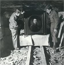 Nazi looted art WWII-A Rembrandt self-portrait was recovered by serg Harry Ettlinger, right, and an offcier at a German salt mine that had been used as a storehouse.