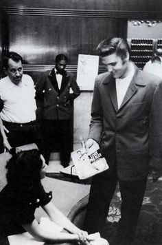 Elvis Presley meets a fan, 1950s.
