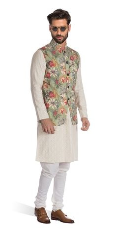 A floral fiesta for the senses, our Bourette silk Nehru vest will take you from a summer wedding to winter cocktails with ease.#Nehruvest #Indowestern