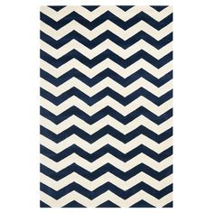 Hand-tufted chevron wool rug.   Product: RugConstruction Material: WoolColor: Dark blue and ivory...