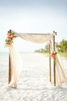 Elegant Draped Beach Ceremony Backdrop | Set Free Photography| http://heyweddinglady.com/tropical-beach-glam-bahamas-wedding-sparkling-gold-pink/