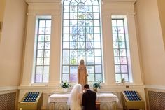 Bridget Nugent and Dean Reineking were wed at St. Martin of Tours church in Amityville, N.Y. (Photo: Danny Kim for The New York Times)
