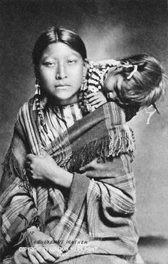 An old photograph of a Young Northern Cheyenne Woman with Child 1907. (Antique photo of Native American)