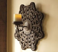 Carved Medallion Wall-Mount Candle Sconce    This is mine now...