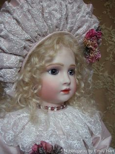 One of my favorite custom orders, a lovely Halopeau reproduction with mauve Hand Glass French paperweight eyes, and costume also made by me in pure silk with French laces and flowers I made myself from hand-dyed rayon ribbons. Emily Hart