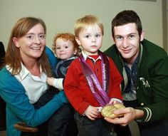 Laura Molyneaux and her sons Harry & Cameron having their photograph taken with Paralympic Double Gold Medallist Michael McKillop.