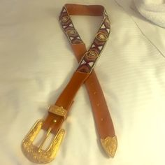Free People belt Excellent condition. Beautiful beaded details. Actual belt is tan and gold. Blue, Green, Tan, White, Gold and Silver beads. Free People Accessories Belts