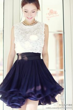 Beautiful lace top with ruffled navy skirt. Gorgeous