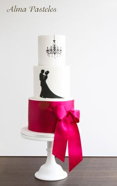 White and pink wedding cake with hand painted couple silhouette