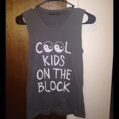 Brandy Melville Graphic Tee Dark grey no sleeve shirt. From Brandy Melville! Price is negotiable.  Brandy Melville Tops