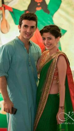 Our favourite celebrity couple, Syra and Shehroz spotted at a Mehndi looking as cute as ever. Syra wearing bottle green saree looks stunning with Orange blouse and golden embroidary work Pakistani Dresses, Indian Dresses, Indian Outfits, Indian Attire, Indian Wear, Eastern Dresses, Desi Clothes, Indian Clothes, Saree Look