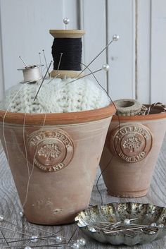 Terracotta pot pincushion - I've seen tiny ones that would look cool
