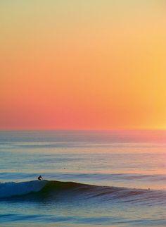 Surf, coucher de soleil
