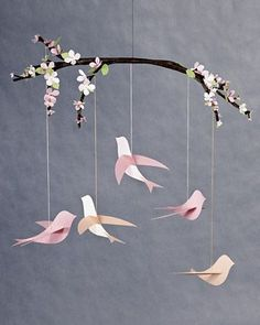 This would be cute, just finding a branch outside, and the bird cut outs in different colors: