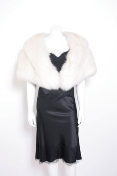 This White Fox Fur Shawl channels more Hollywood glamour than a fur coat.