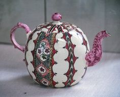 Wedgewood creamware teapot painted In enamel colors; about 1770.  Norwich Castle Museum