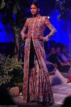Carol Gracias showcases a creation by designer Anamika Khanna on Day 2 of Delhi Couture Week, held in New Delhi, on August 01, 2013.