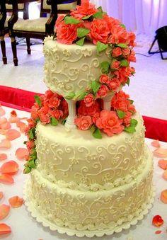 3 tier ivory vanilla wedding cake with red flowers and Roman pillars.JPG