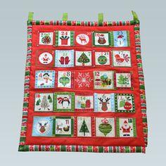"""Un joli calendrier de l'avent en tissu dans les tons rouges et verts """"fait maison"""" à motifs originaux sur le thème de Noël..."""