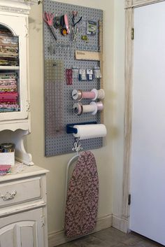 Like the pegboard-this is where the mini ironing board seems to live, too