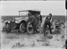 008637PD: Changing a tyre on the Murgoo Station car MU1, 1920 http://encore.slwa.wa.gov.au/iii/encore/record/C__Rb2940912?lang=eng