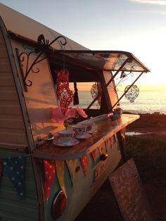 Lady Bonin's Tea Parlour. She goes market to market in her vintage trailer, gypsy style. Take away or sit on cushions set up in front of the caravan.
