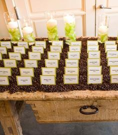 Place cards displayed in coffee beans - fun idea!