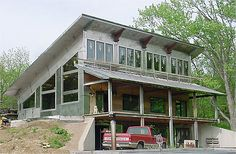 Single slope roof with porch. Stainless steel house?