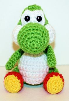 """This Mini Yoshi Gamer Friend, inspired by Yoshi is the perfect companion for that special little game-loving boy or girl in your life! He is 5"""" tall sitting or 6"""" tall standing and just perfect to hold in your hand!"""