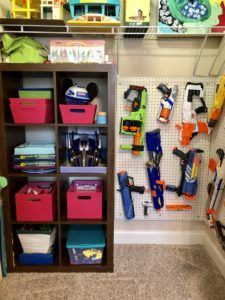 DIY Nerf Gun Wall - build your own solution to store those odd shaped nerf guns and get them off the floor. This easy DIY project can be added to any wall in any size. Toy storage made easy for those hard to organize toys.