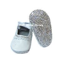 Impossible to not attract attention with these Swarovski encrusted baby shoes! Bling radiates from every angle! Crystals are encrusted on both the soles and fronts of these shoes! A popular choice for christenings! Matches with everything!