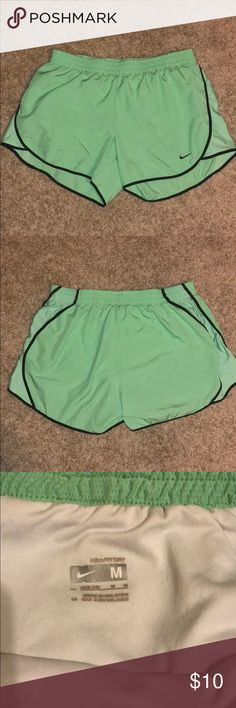 Nike Medium Dry Fit Shorts Nike dry fit shorts. Size medium. Comes with built in undergarment and microphone pouch. In great used condition. Please feel free to ask any questions or request additional pictures (:   I would recommend bundling this with my two other Nike dry fit size medium shorts that are listed in my closet to receive a discount and save on shipping! 😊 Nike Shorts