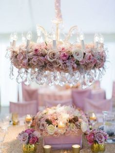 Pastel blooms make a crystal chandelier even more stunning ~ http://www.stylemepretty.com/collection/1962/picture/3010088/