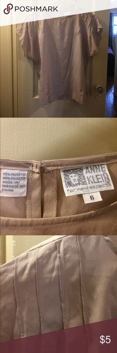 Short sleeve blouse Beige polyester short sleeve t-shirt blouse. Anne Klein size 6 (like a medium). Button back. Worn once. No rips or stains. Open to trades and offers. No returns accepted. Anne Klein Tops Tees - Short Sleeve