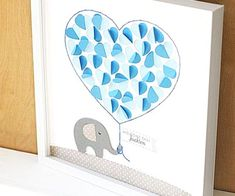 This Baby Shower SignIn doubles as both a sweet keepsake and personalized decor for babys nursery.  Hand crafted from heavy weight textured cardstock this 12x12 guestbook alternative features a baby elephant holding a heart shaped balloon.  The large heart balloon is full of smaller hearts that open up.  Baby shower guests sign their names inside these folded hearts creating a lasting keepsake to remember this special day.  Hand stitching and rickrack complete the design along with a…