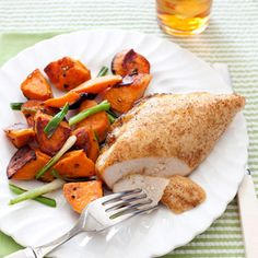 Roasting chicken and sweet potatoes produces a tempting aroma and a delicious meal.  Get the recipe!  - GoodHousekeeping.com