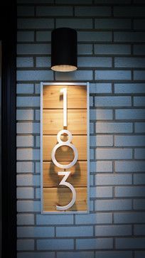 Modern House Numbers Under Outdoor Light.