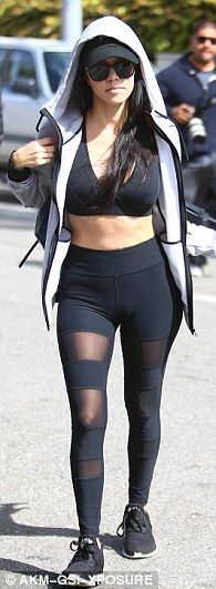 Cut it out: The single mother-of-three bared her belly in a black sports bra and sheer-striped leggings topped with a grey Adidas hoodie