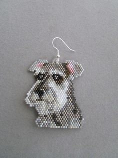 These adorable beaded Schnauzer earrings measure 1-5/8 inches wide and 2-1/8 inches long, excluding the ear wires. I have used brick-stitch and approximately 1490 tiny delica beads, intricately woven together, one bead at a time, with a beading needle and beading thread to create the finished earrings you see here.  They would make a great gift for any dog lover, especially a Schnauzer owner, or maybe even a gift for yourself!  The pierced fishhook ear wires are silver plated surgical steel…