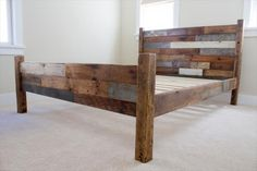 Queen Bed Frame RESERVED for Alan - - Reclaimed Pallet and Barn Wood Queen Bed headboard frame… Cheap, easy, low-waste Reclaimed Wood Bed Frame, Wooden Bed Frames, Simple Bed Frame, Diy Bed Frame, Headboard Frame, Headboard Ideas, Pallet Beds, Pallet Furniture, Pallet Wood