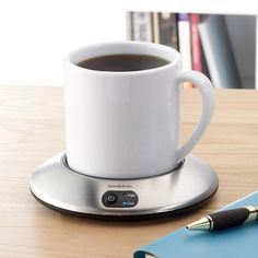 Mug / Coffee Cup Warmer. I need one of these for my desk at work!