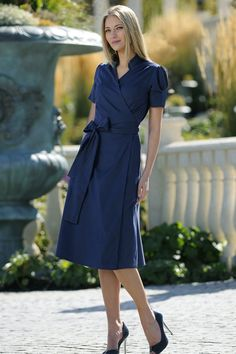 That blue would look fabulous on just about any skin color. I can't always wear just any color, but that is a nice blue! I love the bow on the side, and the shirt dress style. Plus...it's just at/below the knees, which would be perfect!