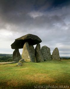 Standing stones at Pentre Ifan in Pembrokeshire, Wales. This Bronze Age monument, also known as Arthur's Quoit, dates from around 4000-3500 BC. It is thought to have been constructed as a burial chamber and would have originally been covered in earth. The capstone of the chamber is about 5 metres long. Photographed in Pembrokeshire Coast National Park, Wales.