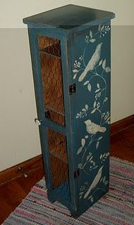 cabinet repainted, stenciled and chicken wire added to front