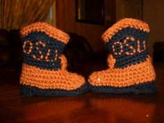 Using the cowboy bootie pattern available on the Internet or YouTube, I used the Oklahoma State University colors and initials as the baby's parents are huge OSU fans.