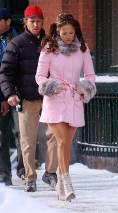JLO Rockin This Winter Look! Love the Pink Coat & Ponytails!