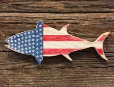 This listing is for a 13 x 6 wood tuna painted white, red, and blue. He is the PERFECT decoration for any nautical living area! This guy is a